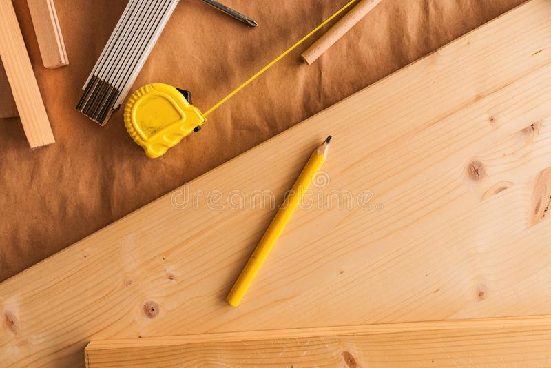 Pencil on woodwork carpentry workshop table. With other tools of trade for diy hobby project royalty free stock photos