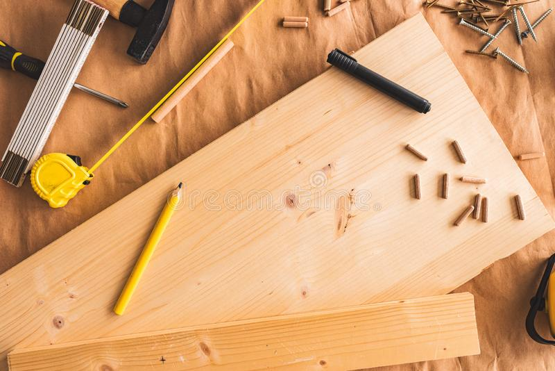 Pencil on woodwork carpentry workshop table. With other tools of trade for diy hobby project stock image