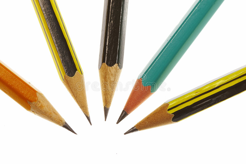Pencils. Macro picture of some cloistered graphite pencils over white stock images