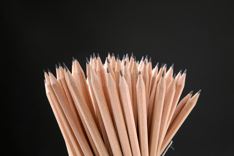 Pencils. Bunch of pencils isolated on black royalty free stock images