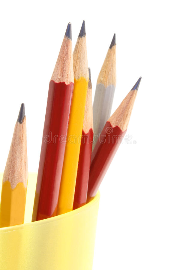 Pencils. In yellow cup on white background stock photo