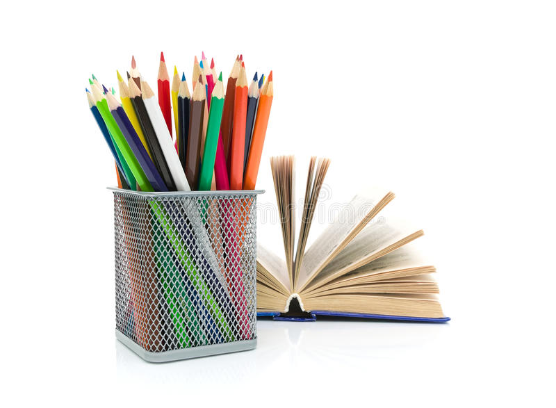 Pencils and books. white background - horizontal photo. Pencils of different color and an open book. white background - horizontal photo stock image