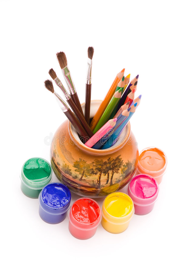 Pencils and brushes in vase