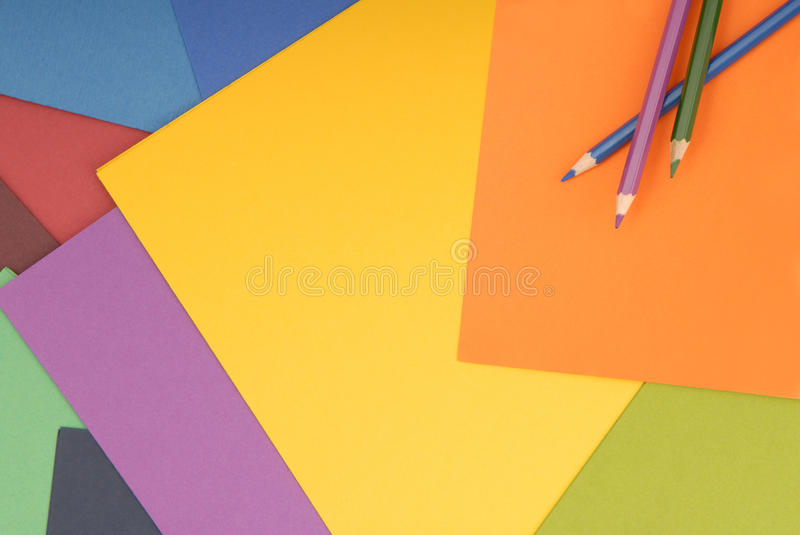 Pencils are on colored paper. stock photos