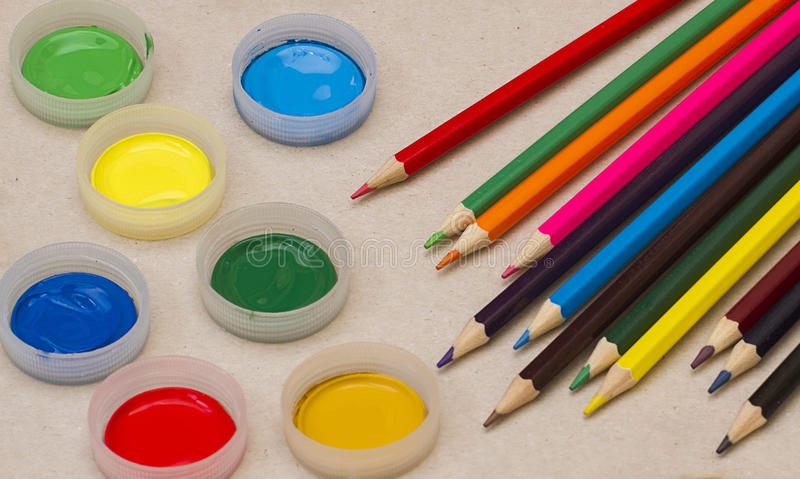 Pencils and cover with paint gouache royalty free stock photo