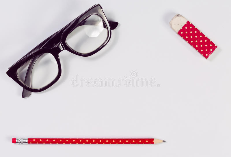 Pencils,eraser,glasses, isolated on white royalty free stock images