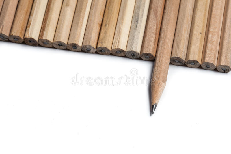 Pencils in line which one point in different direction royalty free stock image