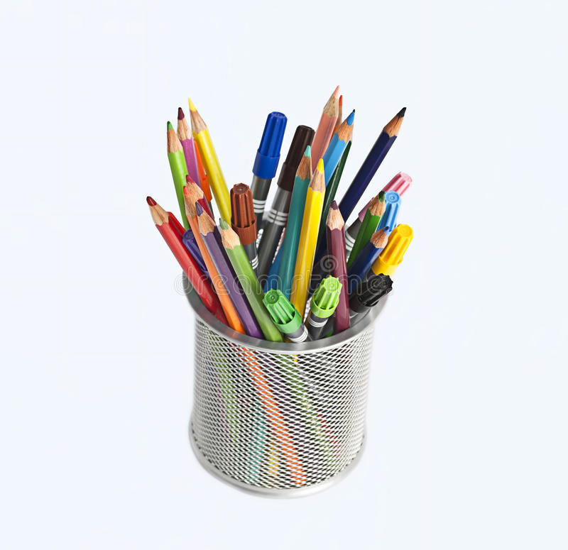 Pencils and markers in metal pen holder royalty free stock image