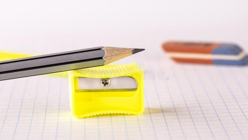 The pencils with pencil sharpener and eraser isolated on white background stock images