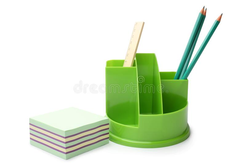 Pencils and ruler in holder with sticky notes royalty free stock photography