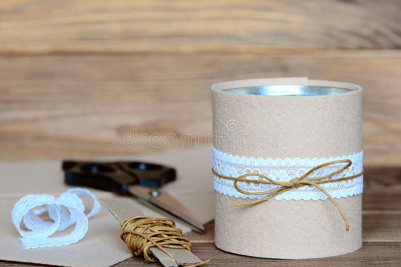 Pencils and scissors decorative holder. Recycled tin can for storage of stationery. Tin can embellished with felt and lace royalty free stock photography