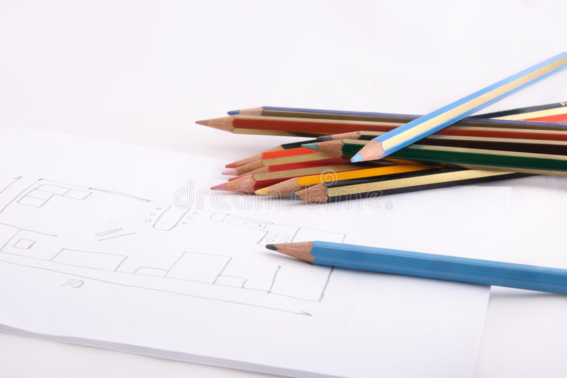 Pencils and sketch. Bunch of color pencils and lead pencil is lying on sketch of design room royalty free stock photography