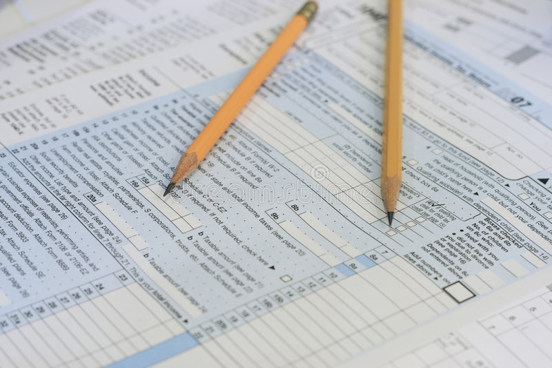 Pencils on tax forms. Two sharpened pencils sit on IRS tax forms ready to compute royalty free stock images