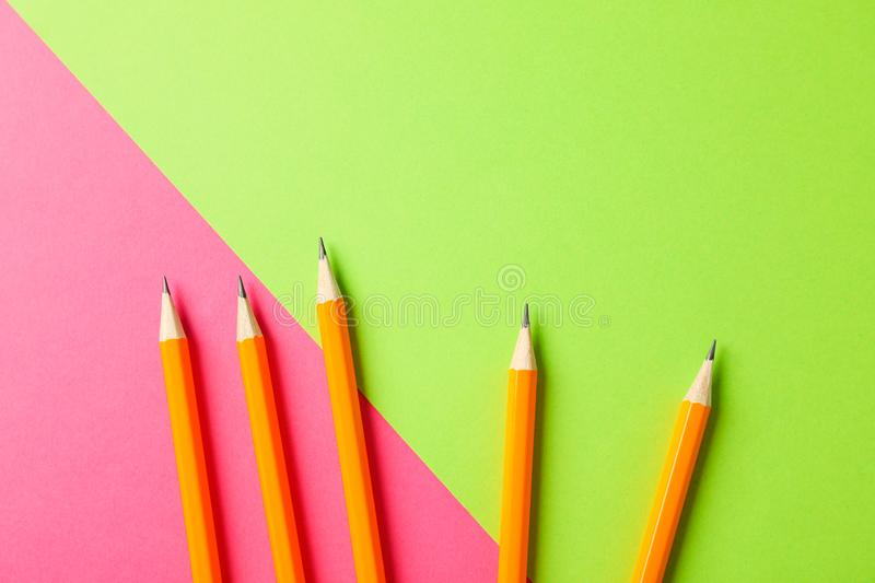 Pencils on two tone background. Space for text stock photography