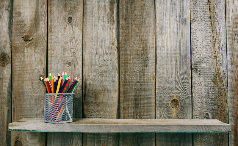 Pencils on a wooden shelf. stock photo