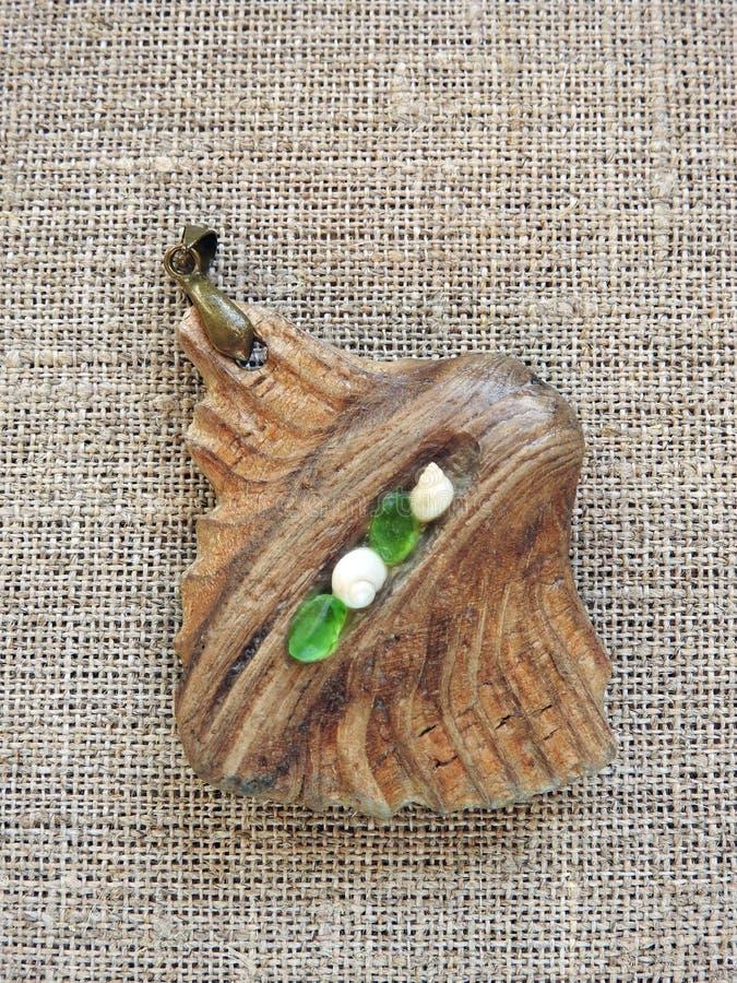 Pendant  done using sea wood and sea glass, Lithuania stock photo