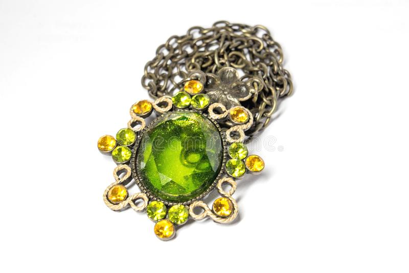 A pendant with a green stone on a chain stock photography