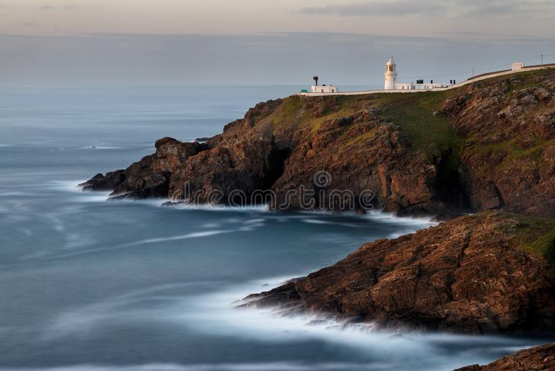 Pendeen lighthouse - long exposure. Pendeen lighthouse in Cornwall taken with a long exposure to give an artistic effect royalty free stock images