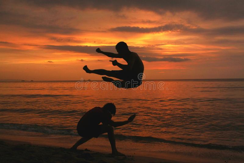 Folks. Sunset at Carita Beach stock images