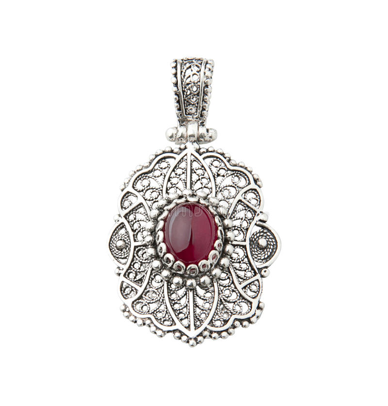 Pendente de prata decorado pelo gemstone vermelho imagens de stock royalty free