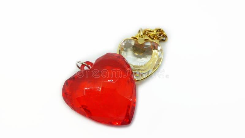 Pendentes vermelhos e claros da forma do coração foto de stock royalty free