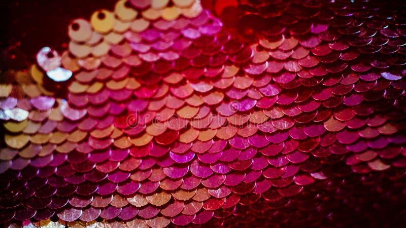 Pendiente roja del fondo de la lentejuela de la tela que brilla fotos de archivo