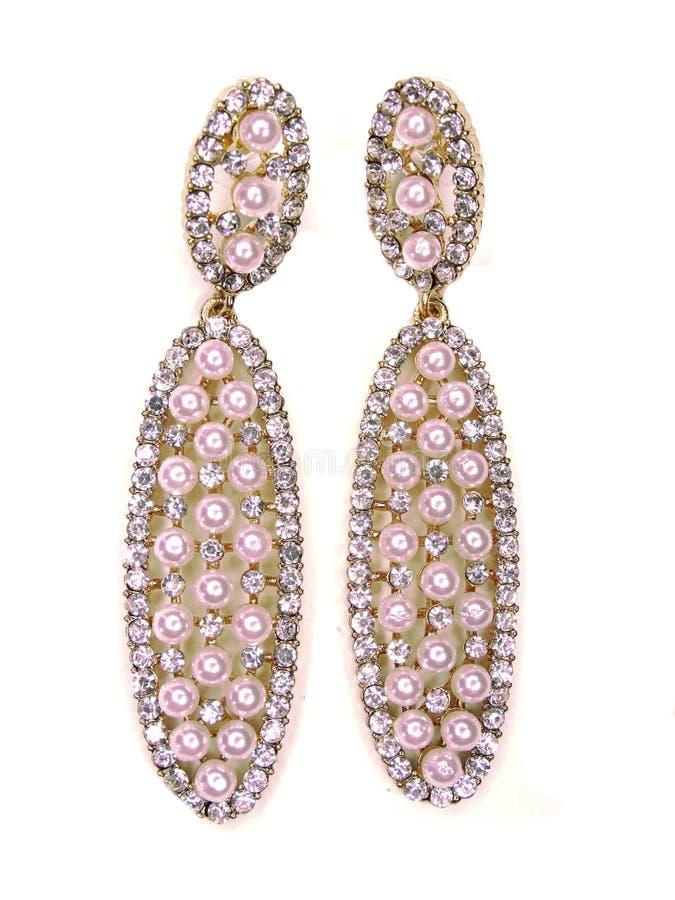Pendientes de la perla con joyería brillante de los cristales fotos de archivo