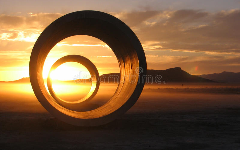 Pending Solstice at Sun Tunnels. Sun setting through the sun tunnels at sunset during the summer solstice. Located out in the remote Utah desert near the Nevada stock images