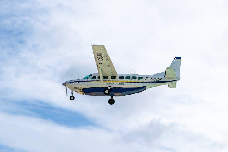 Pendlareflygplan för St Barth, en regional trafikflygplan Cessna 208B för storslagen husvagn arkivbilder