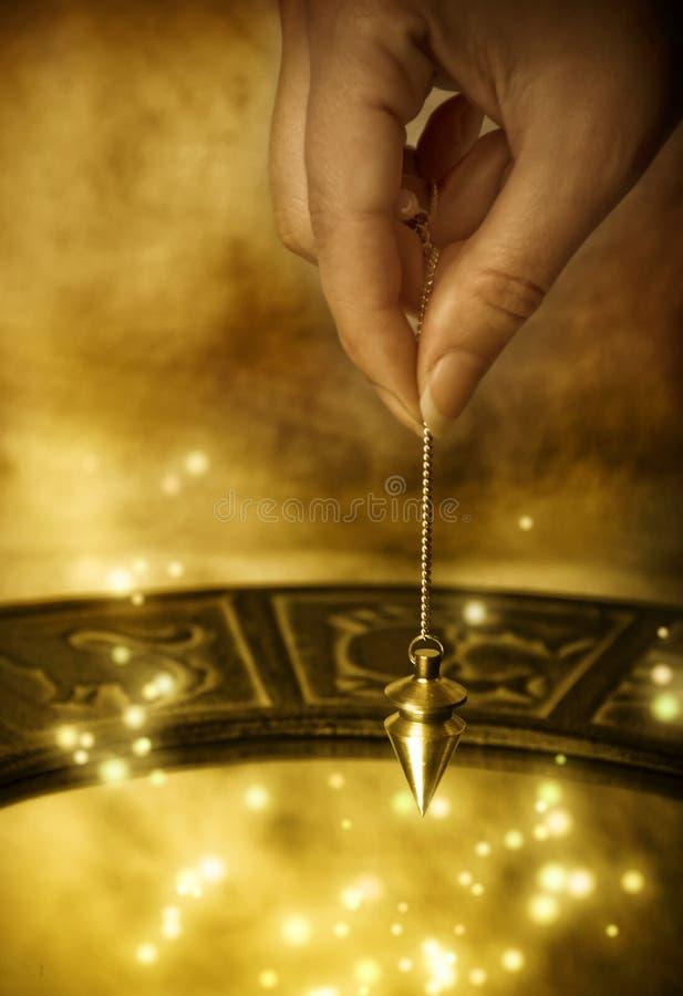 Pendule magique photo libre de droits