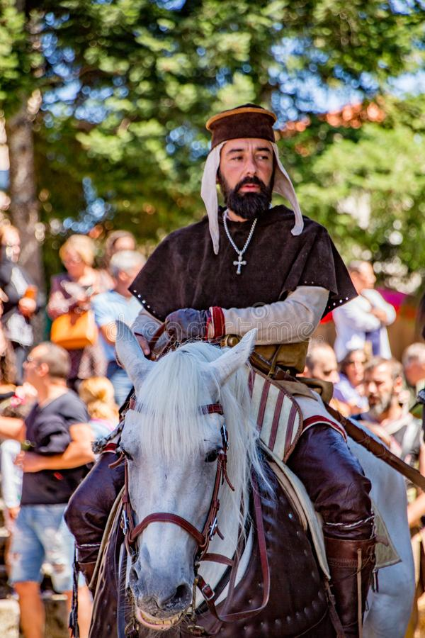 Penedono , Portugal / July 1, 2017 - Man rides horsebase dressed as a priest in Medieval fair stock photos