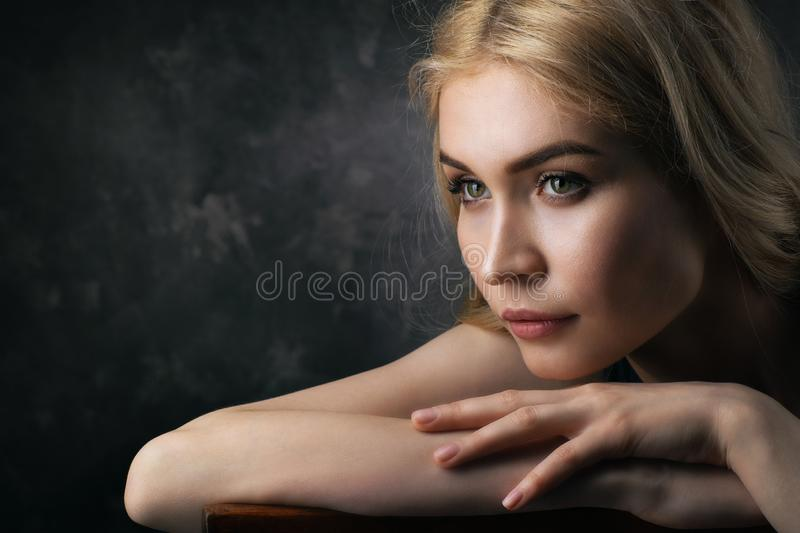 Penetrating glance of the glamourous blonde. A portrait with the copy of space royalty free stock photos