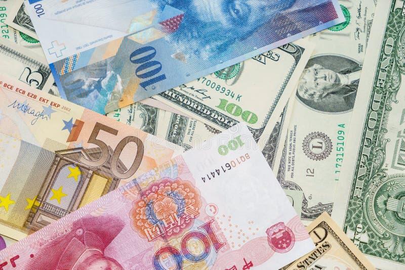 Pengar av världen arkivfoto
