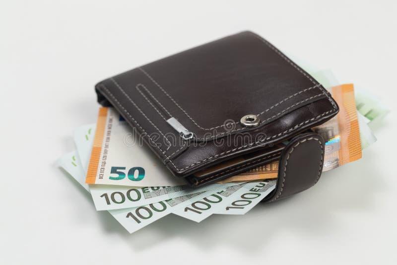pengar Euro Dollarräkningar är på en vit bakgrund fotografering för bildbyråer
