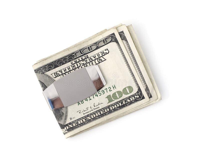 Pengar fäster ihop arkivbild