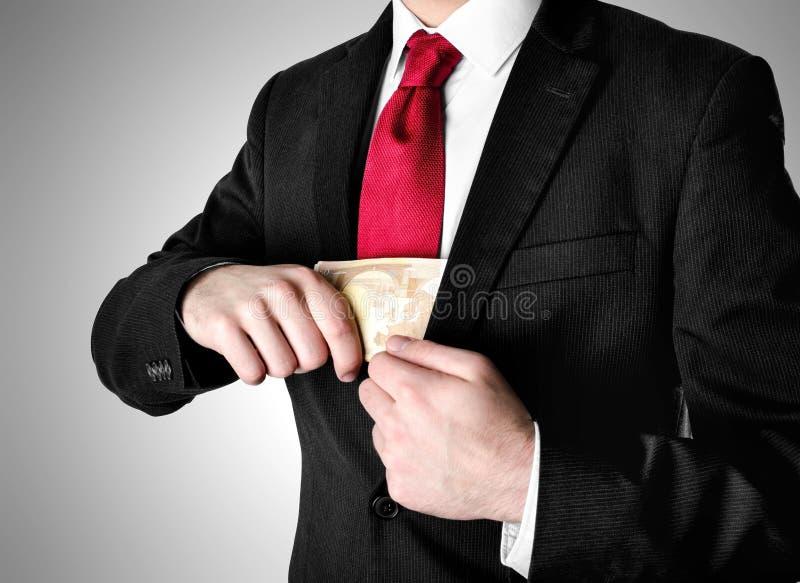 Pengar för häleri för iklädd dräkt för affärsman royaltyfri fotografi