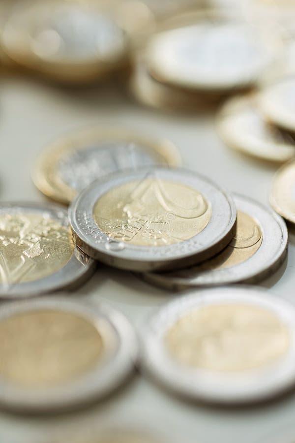 Pengar finanser coins euro royaltyfria bilder