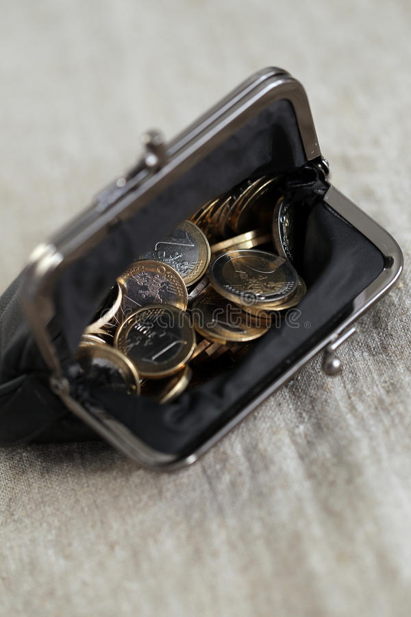 Pengar finanser coins euro arkivbilder