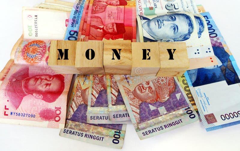 Pengar i asiatiska valutor royaltyfri bild