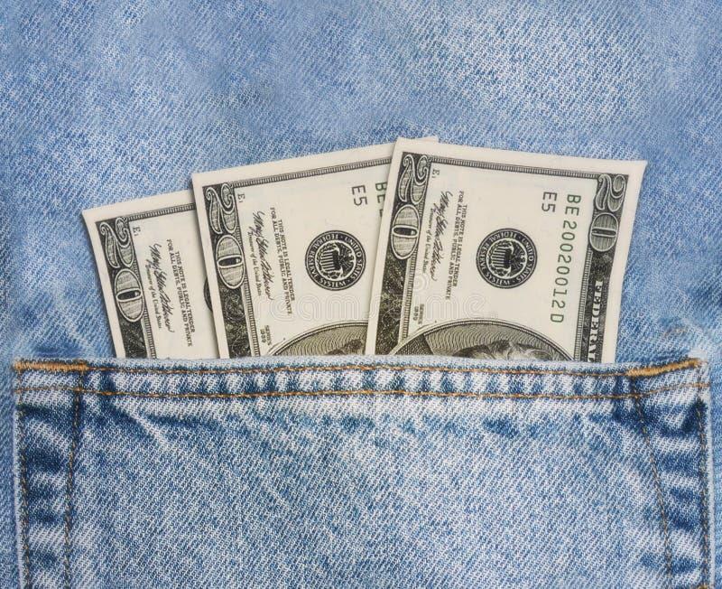 Pengar i ditt fick- royaltyfri bild