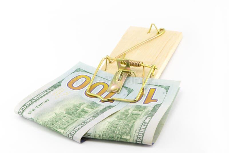 Pengar i en mousetrap royaltyfri fotografi