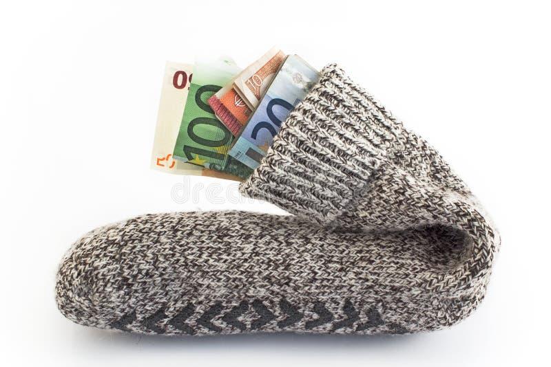 Pengar i en socka royaltyfri foto