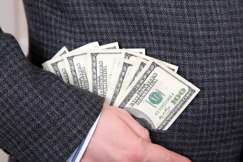 Pengar i ett fick- arkivfoton