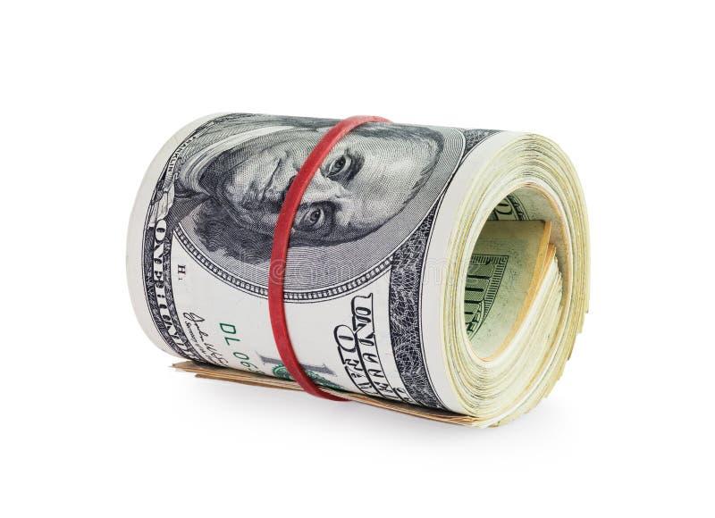 Pengar i rulle arkivbilder