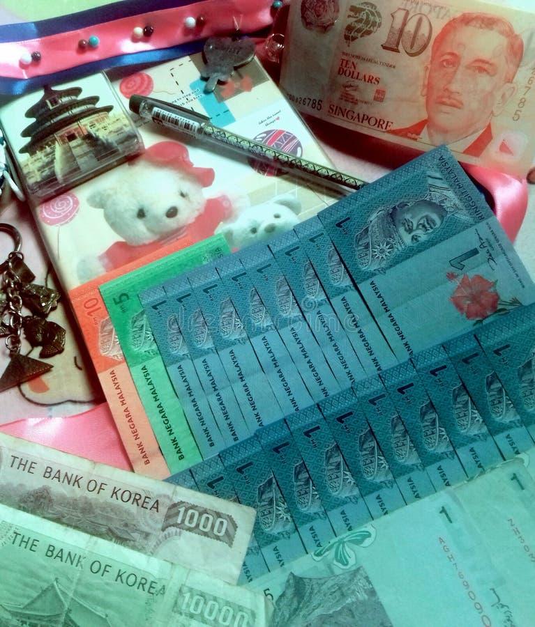 Pengar Korea singapore Malaysia royaltyfri bild