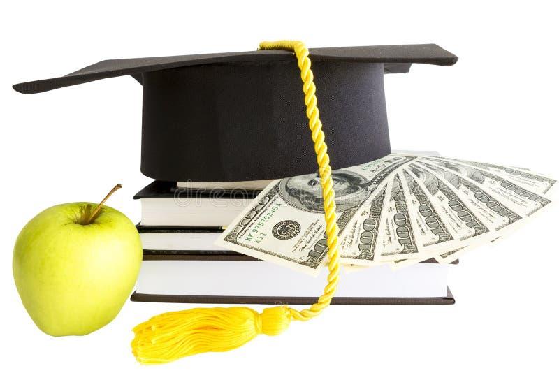 Pengar och böcker för skola arkivbilder