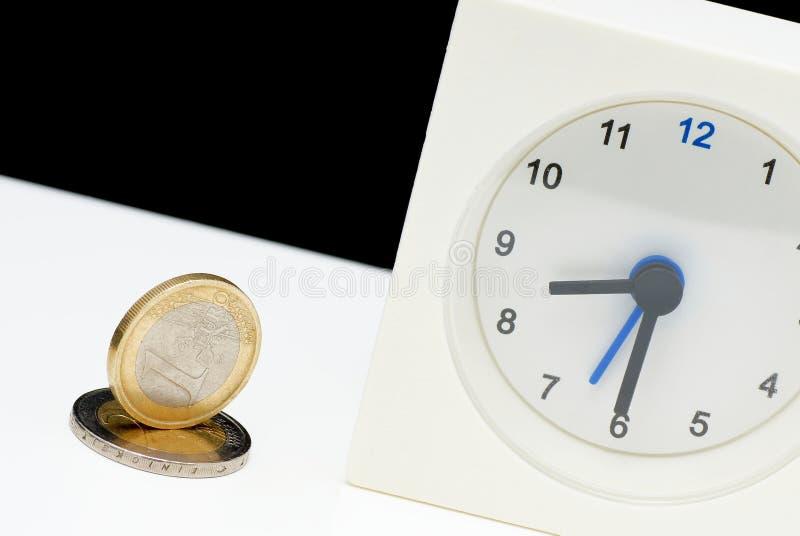 Pengar och tid. royaltyfria foton