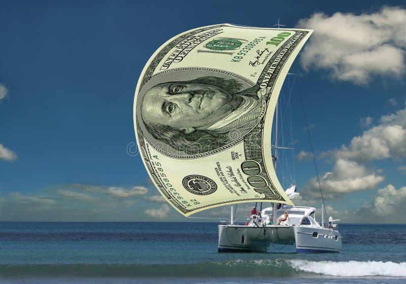 pengar seglar segelbåten arkivfoton