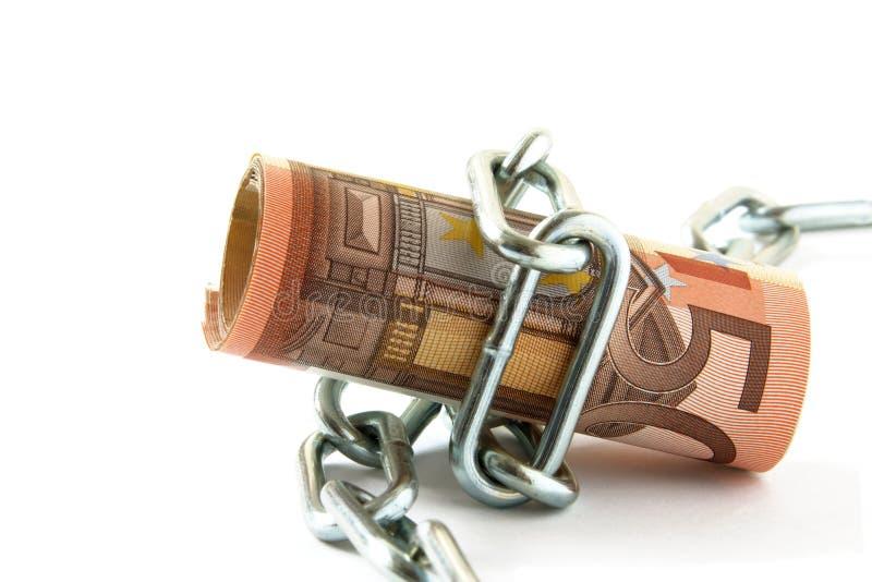 pengar som binds upp arkivfoton