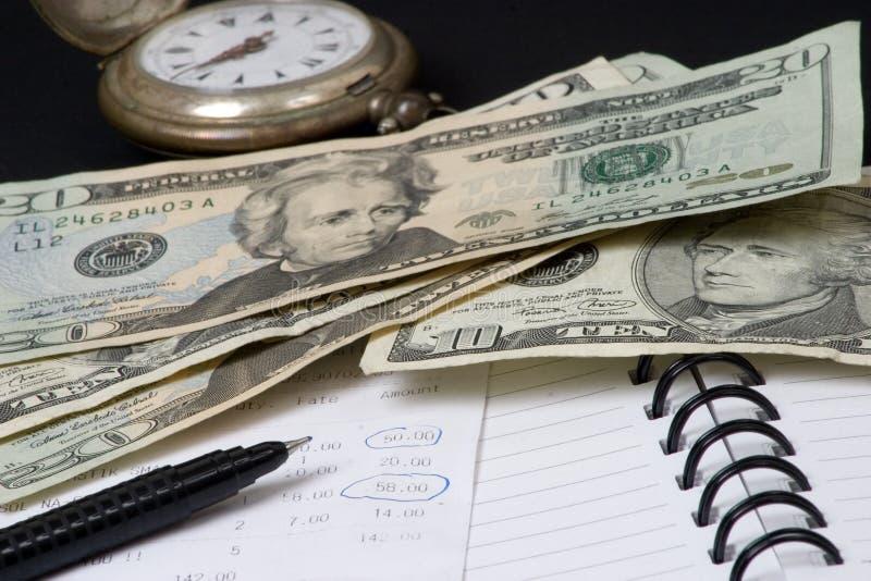 pengar sparar tid till arkivbild